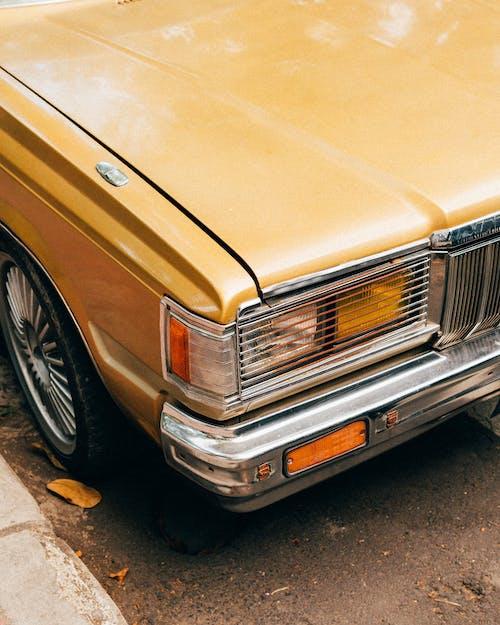 Brown Car on Gray Concrete Pavement