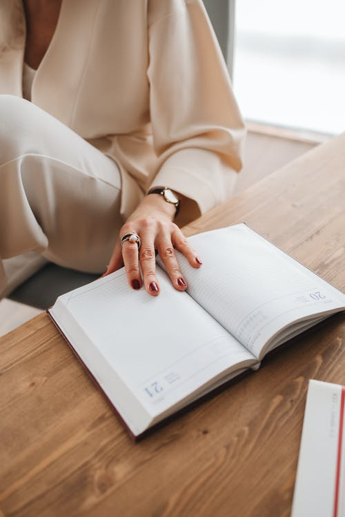 Person Holding a Diary