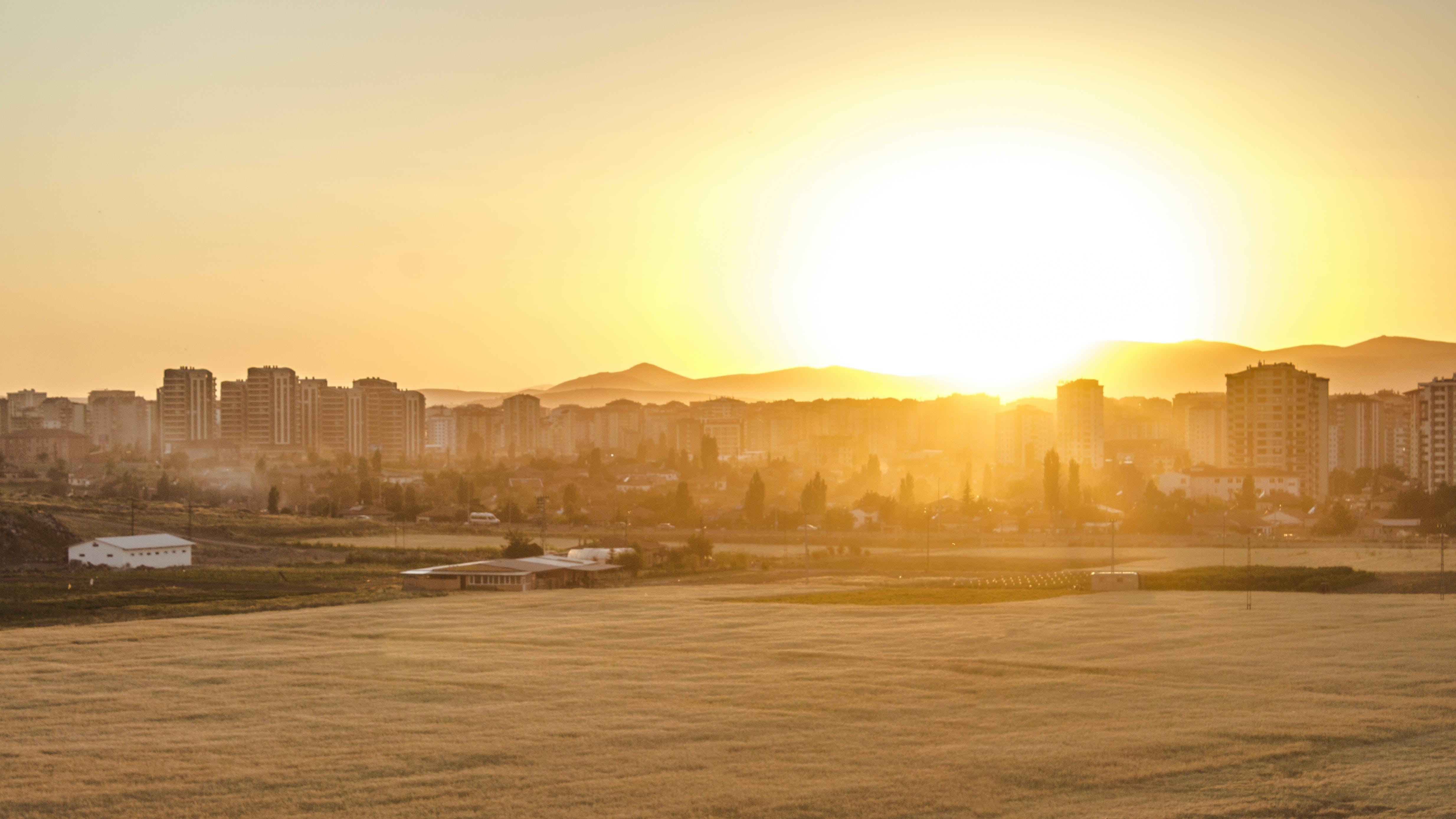 Free stock photo of city, sunset, field, yellow sun
