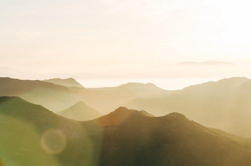 Mountain Ranges Under White Sky