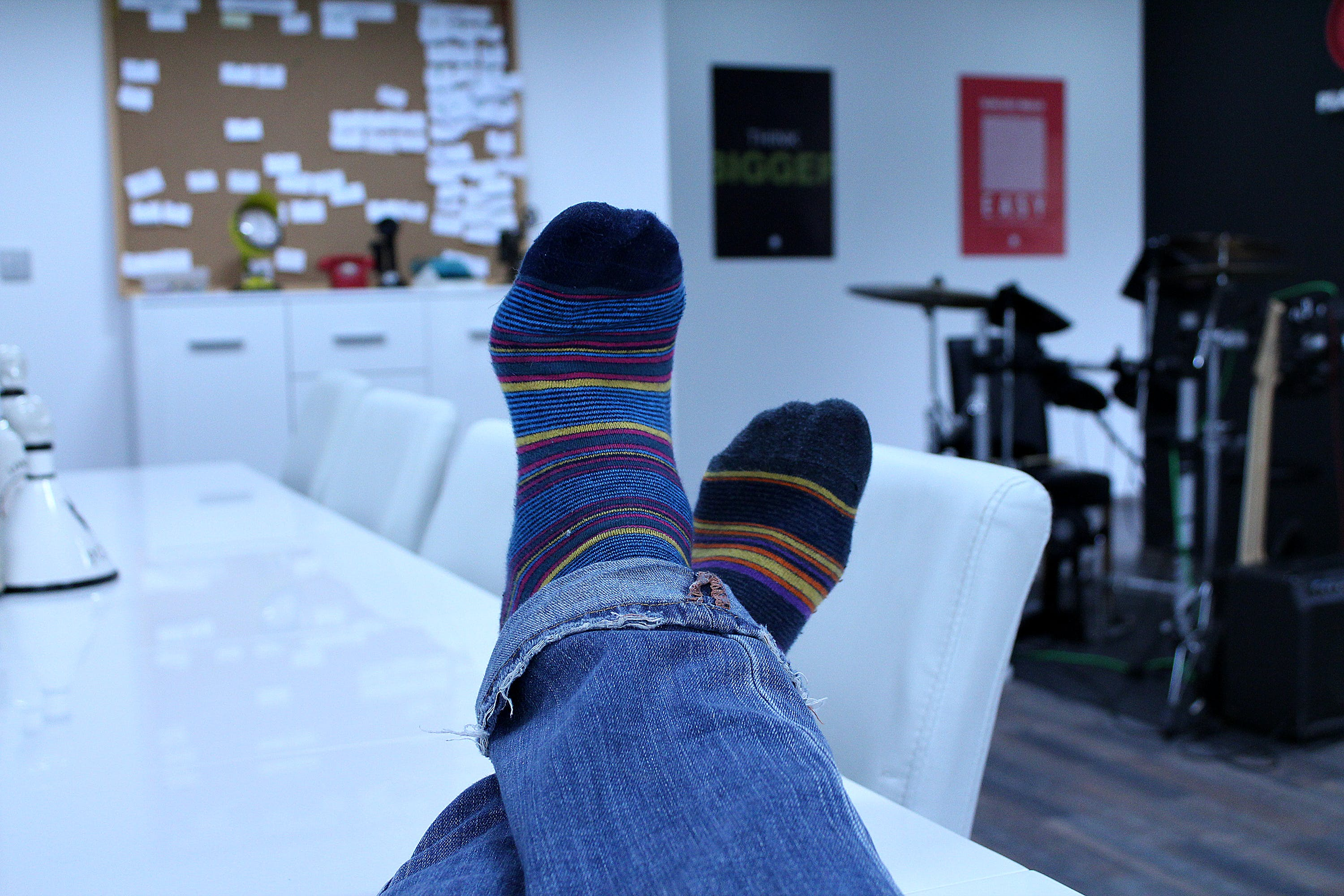 Person Wearing Blue Black Yellow Red Socks