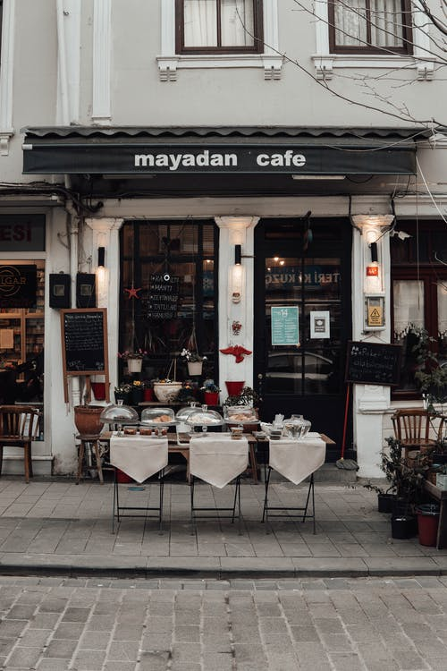 Street cafe with set table and chairs