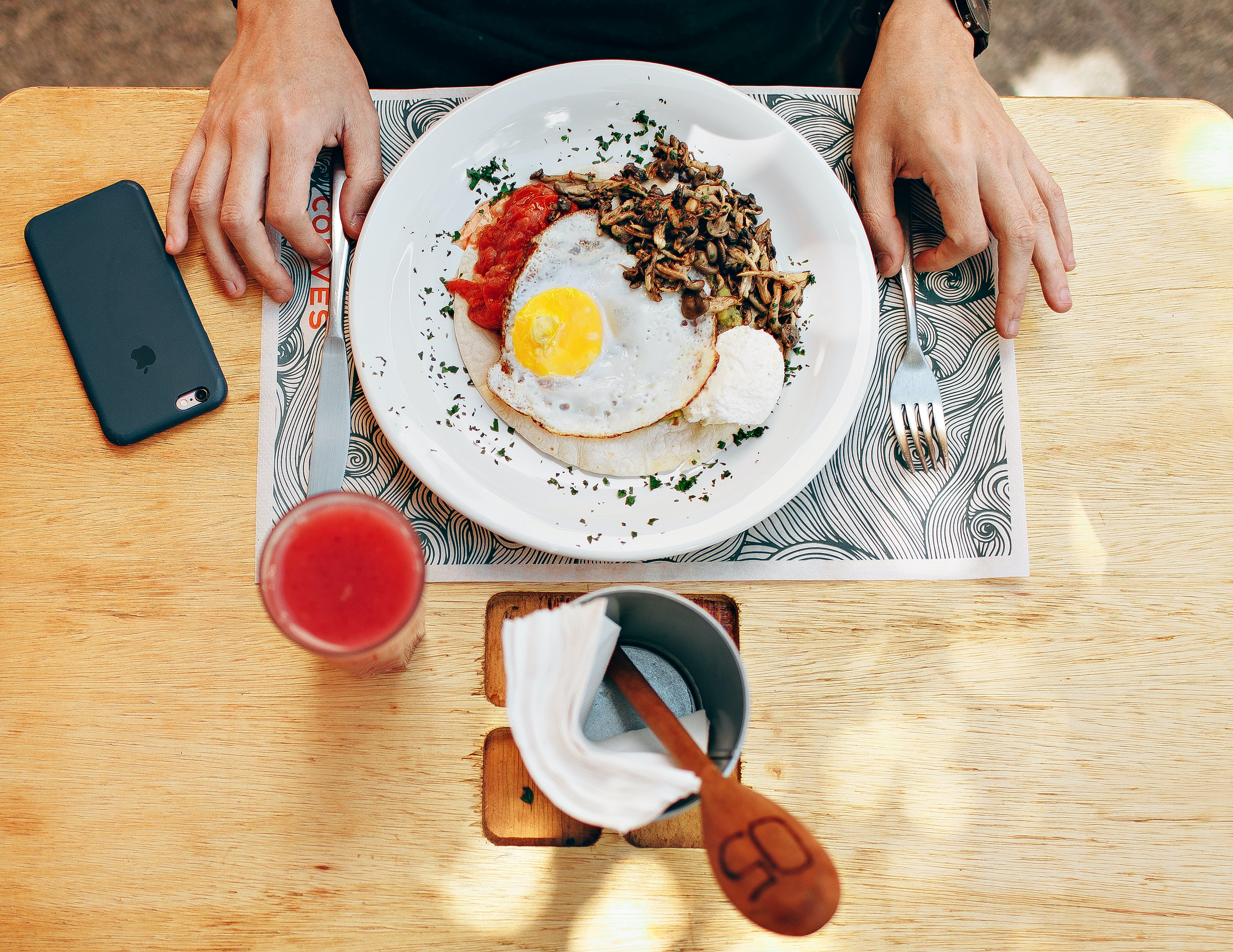 Fried Egg With Plain Rice on White Plate Beside Stainless Steel Fork With Clear Drinking Glass on Top Table