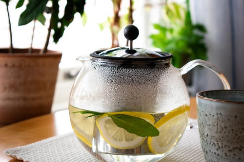 Clear Glass Teapot With Lemon Juice