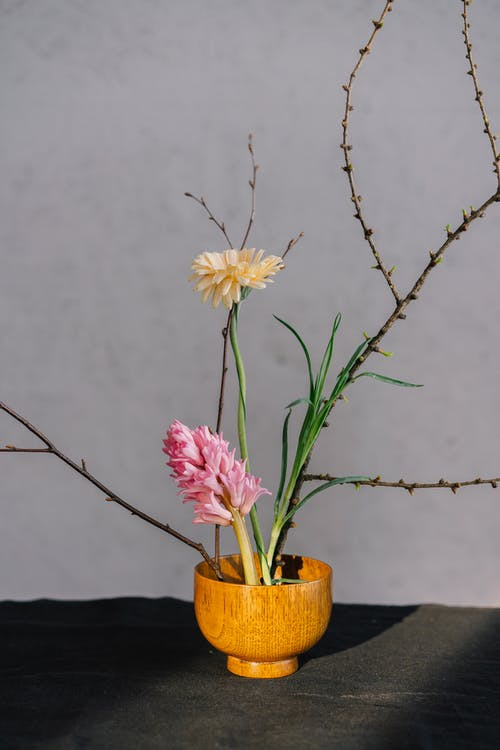 White and Yellow Flowers in Brown Ceramic Vase