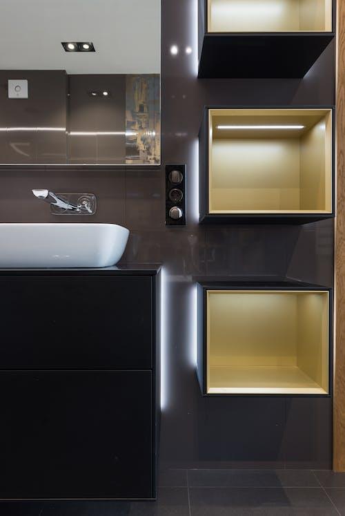 Shelves near sink and mirror in modern bathroom