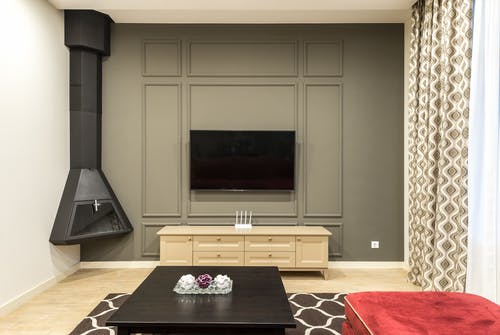 Spacious lounge with metal fireplace and TV