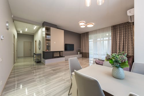 Interior of modern flat with living area and dining zone