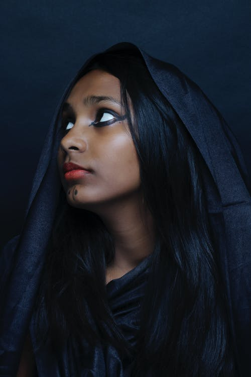 Closeup Photography of Woman Wearing Black Robe