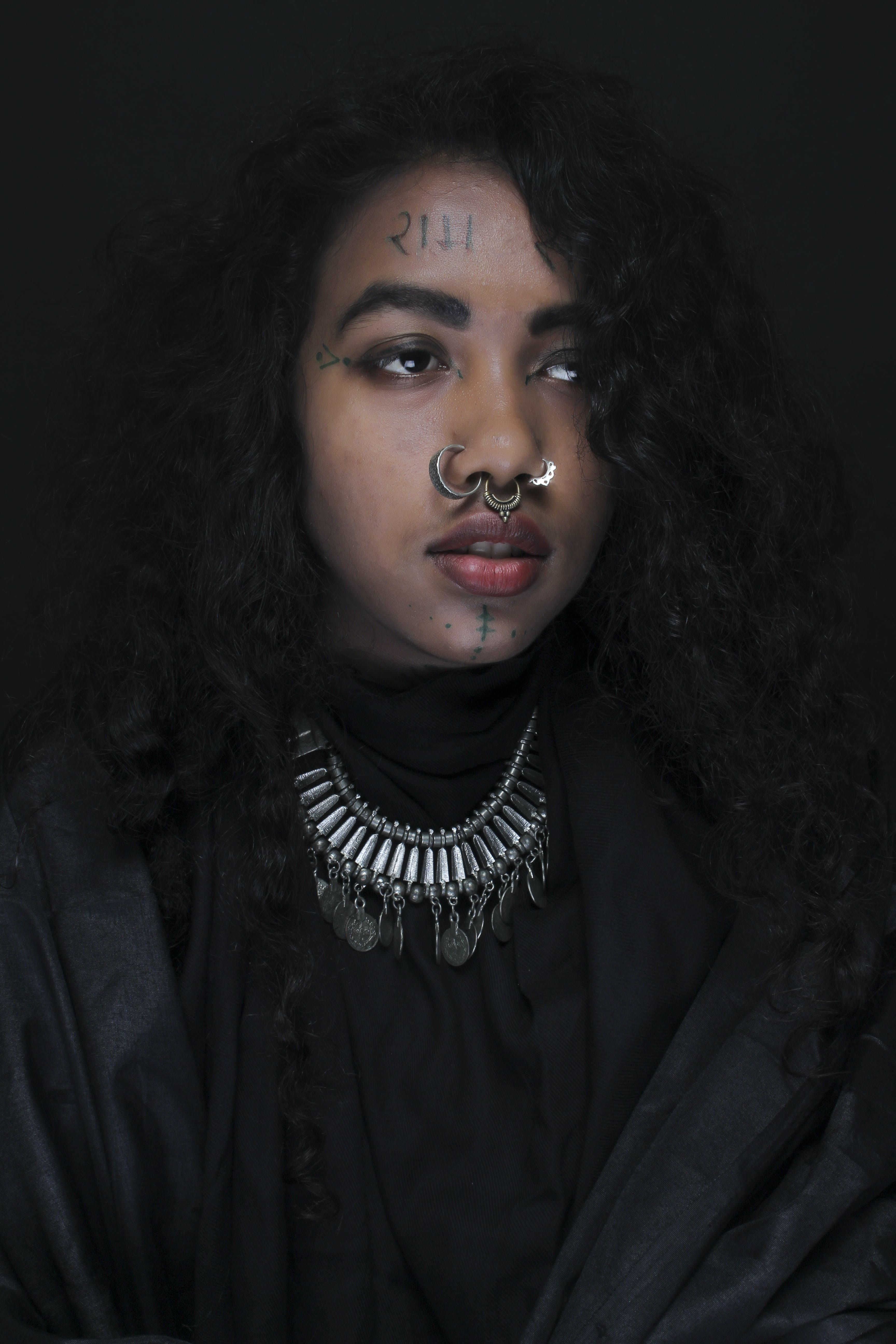 Woman Wearing Black Dress With Silver-colored Nose Piercings