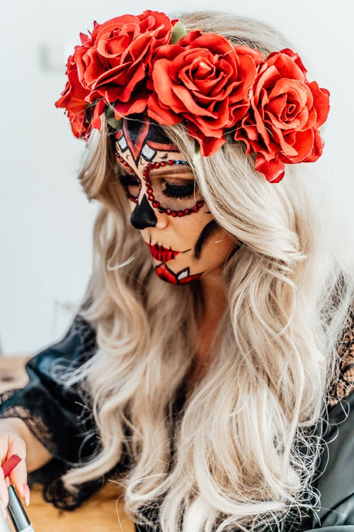 Woman With Flower Headdress and Face Paint