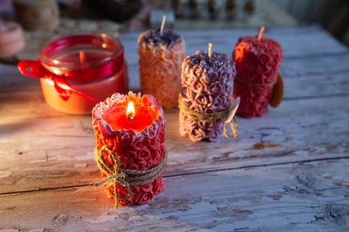 Three Red Candles on Brown Wooden Table