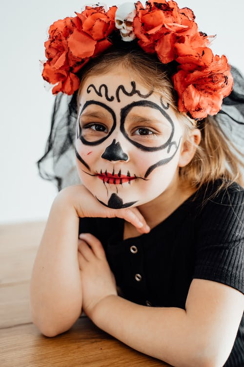 Pretty Girl With Creative Makeup and A Headdress of Flowers