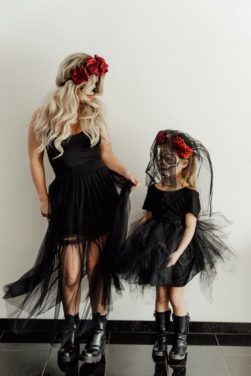 Mother and Daughter in Black Tulle Dress Standing Side by Side