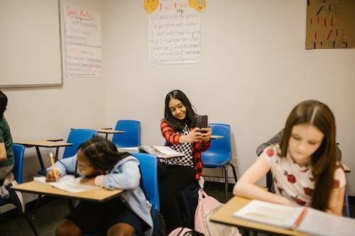 Girl Taking Photo of Her Classmate