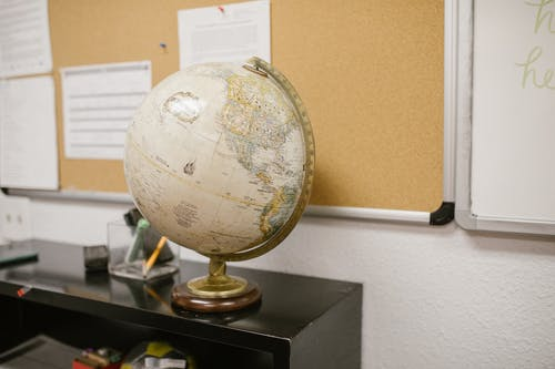 White and Gold Desk Globe on Black Table