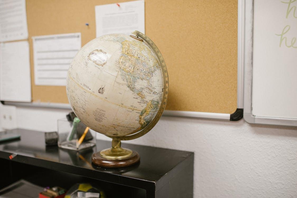 White and Gold Desk Globe on Black Table