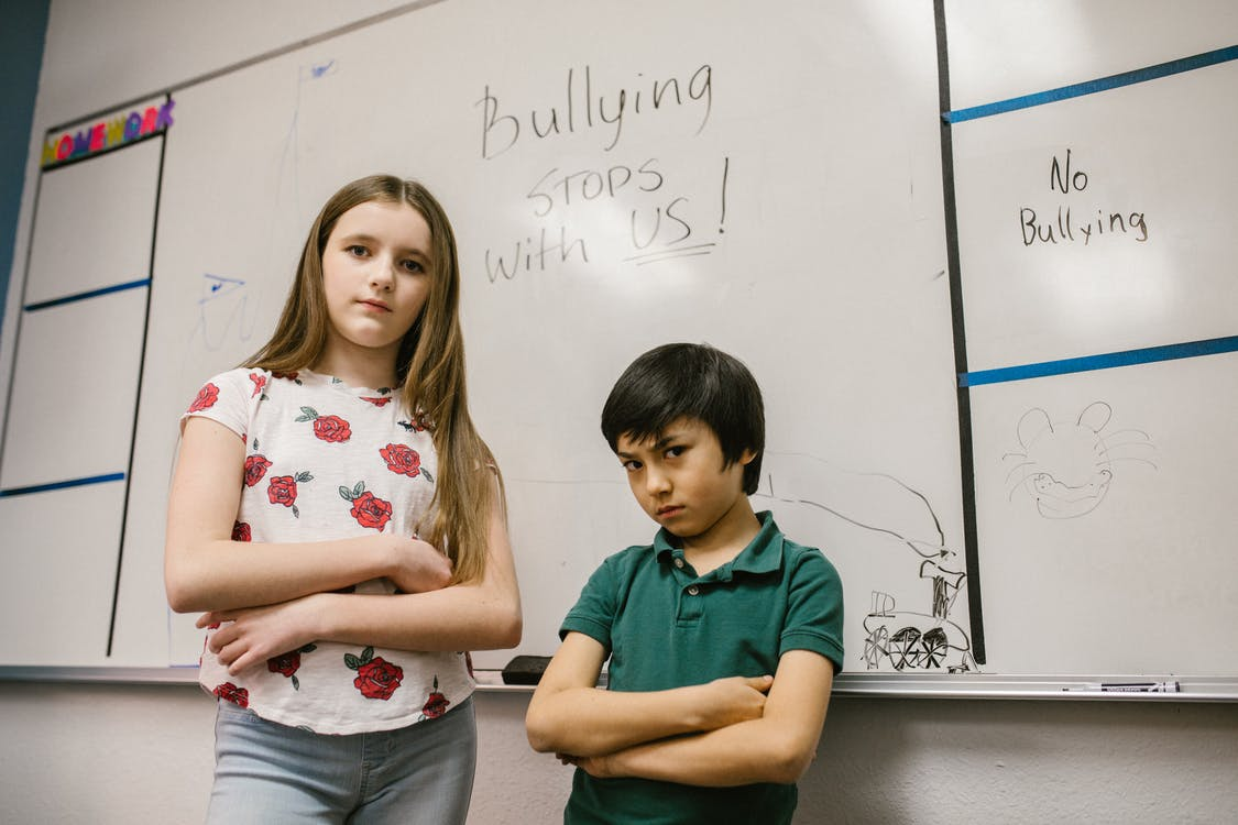 Two Students Looking Angry at the Camera