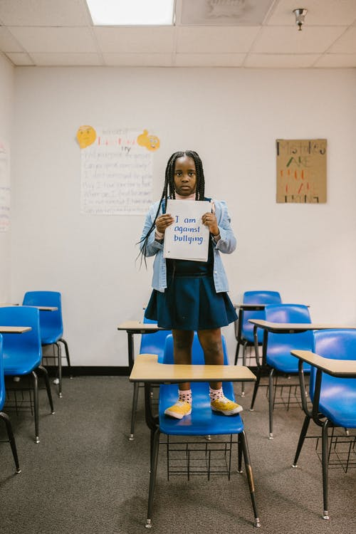Girl Showing a Message Written in a Notebook