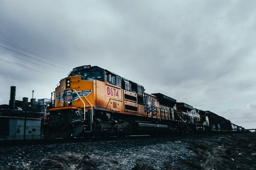 Train driving along railroad