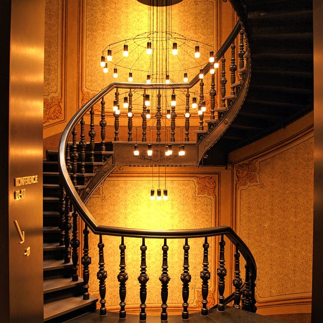 Brown wooden stairs and chadelier
