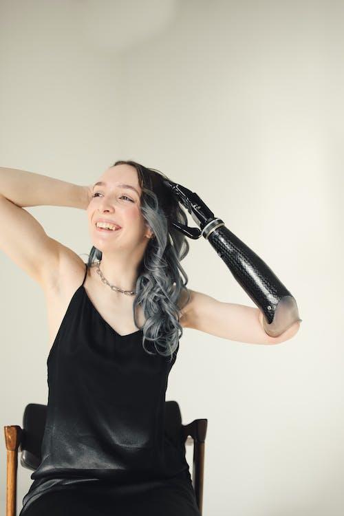 Kostenloses Stock Foto zu bionisch, dame, erfreut
