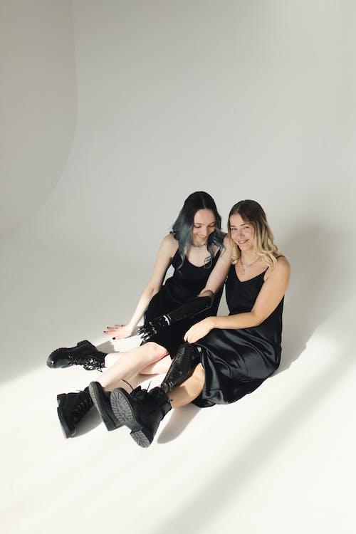 Photo Of Women Sitting On The Floor