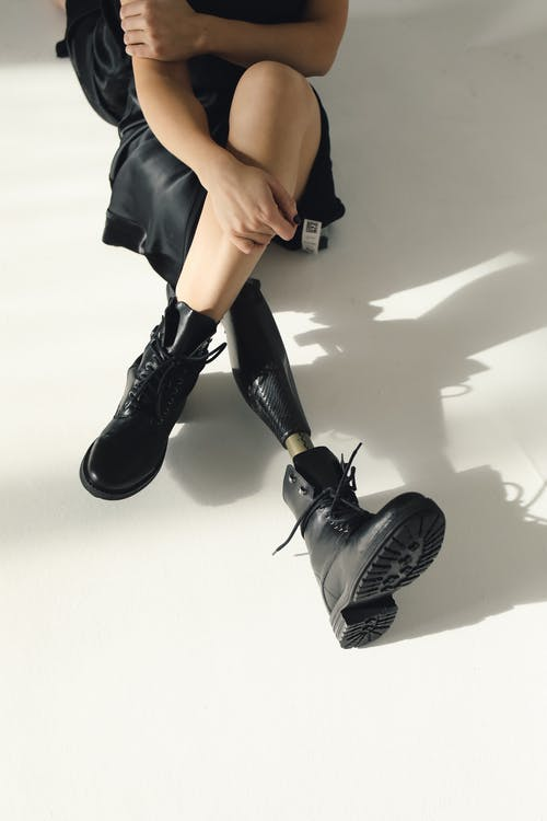 Photo Of Person Wearing Black Leather Boots