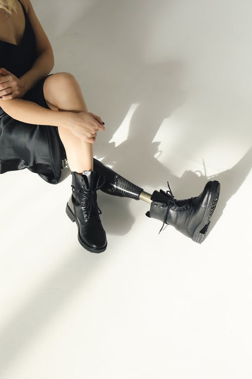 Photo Of Woman In Black Leather Boots