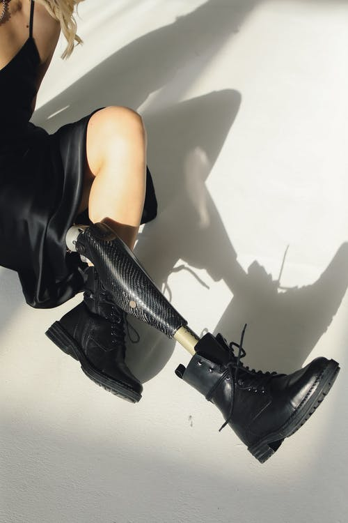 Photo Of Person Wearing Black Leather Shoes
