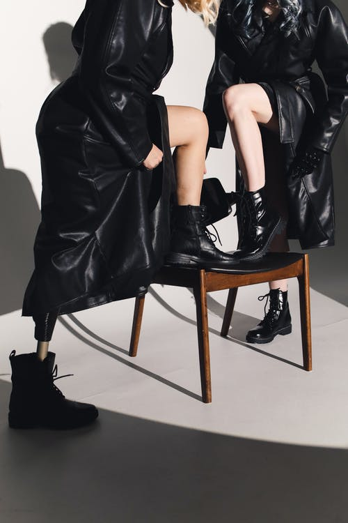 Photo Of Legs Up On Wooden Chair