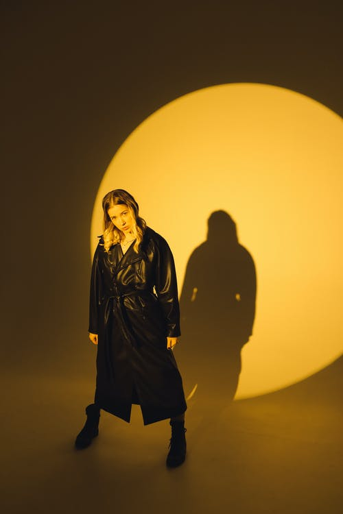 Photo Of Woman Standing Wearing Black Leather Coat