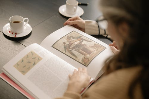Person Looking at a Book