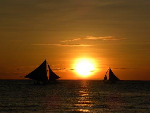 Photos gratuites de bateaux, ciel, coucher de soleil, mer
