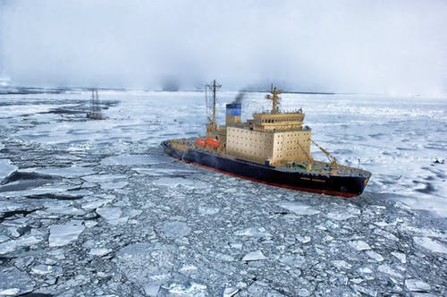 Black and Gray Ship on Water With Ice