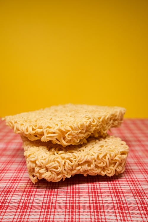 Uncooked dried noodles placed on table