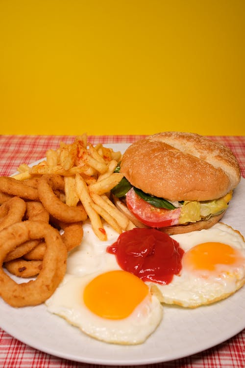 Delicious sandwich with fried potatoes and onions and eggs served on plate