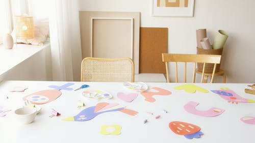 Colorful Artworks on White Table