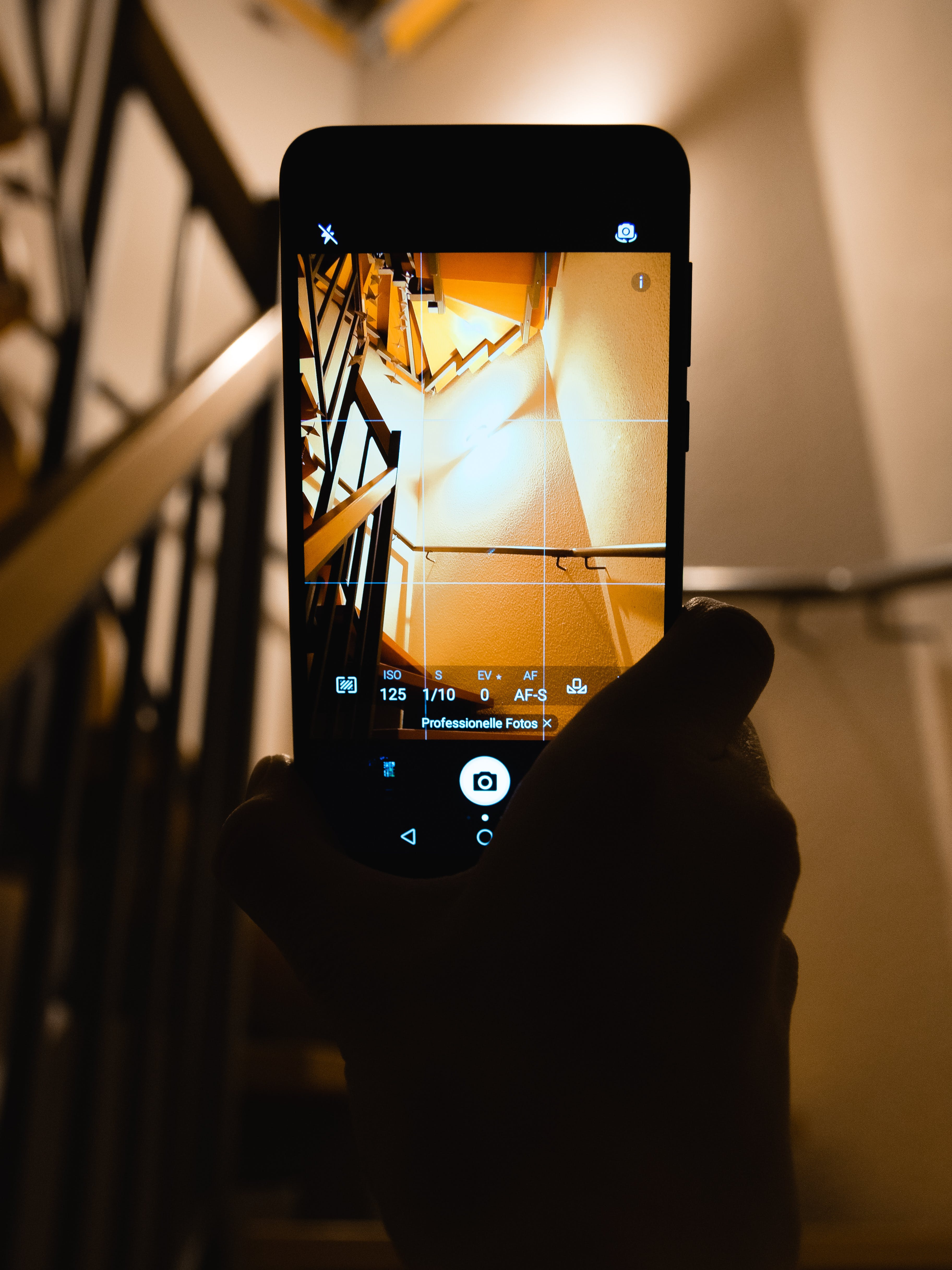 Person Holding Smartphone Showing Camera Application