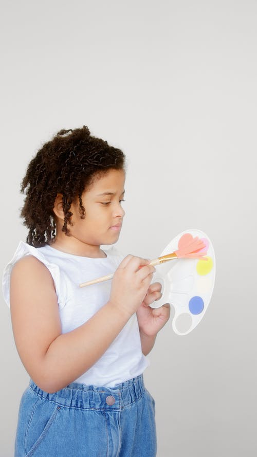 Girl Holding Paintbrush and Palette