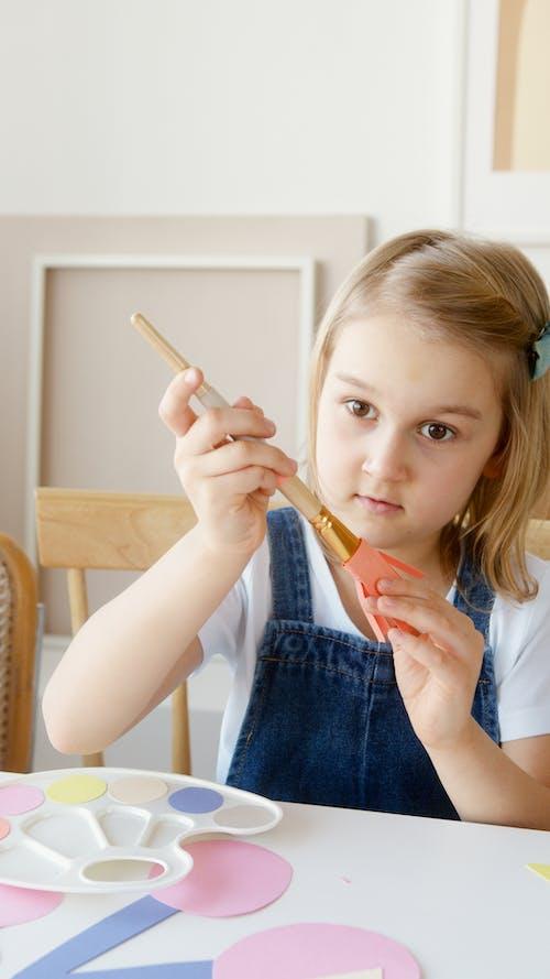 Girl Holding a Paintbrush