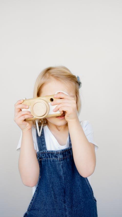 Girl Taking Photo Using a Camera
