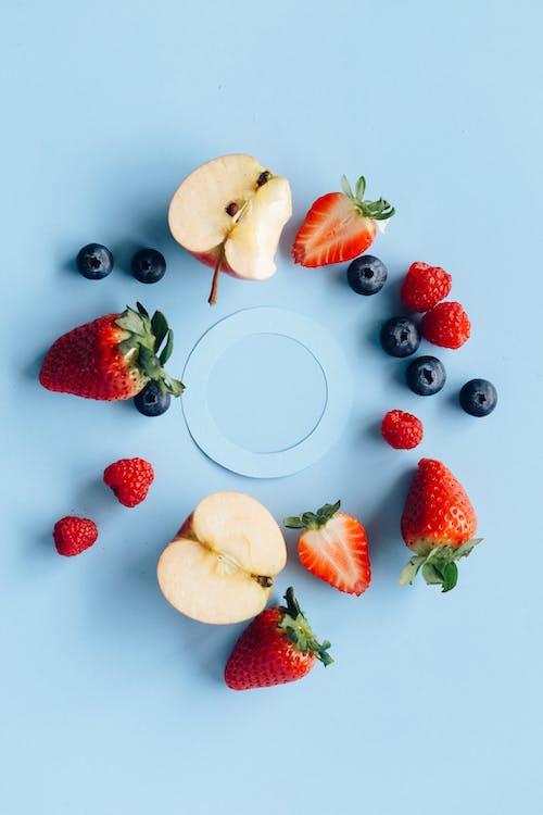 Sliced Lemon and Strawberries on White Ceramic Plate