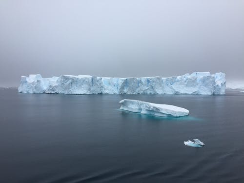 Landscape Photography of Glacier on Ocean