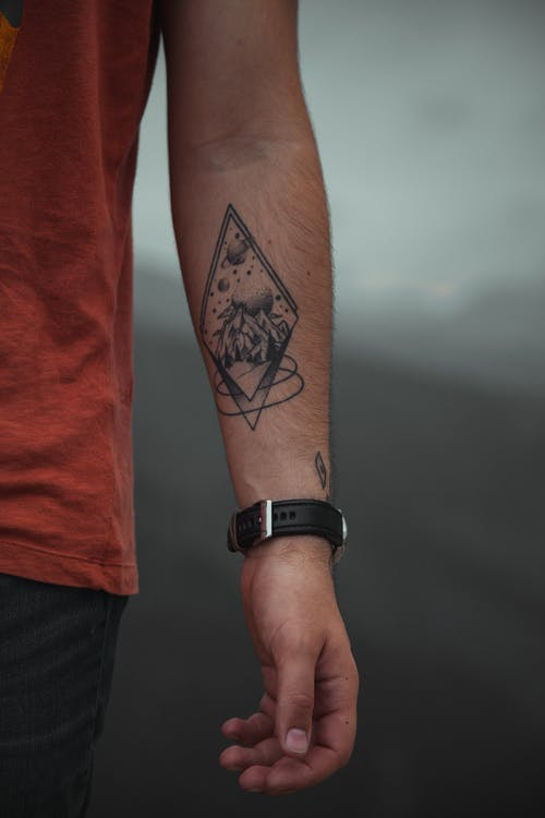 Unrecognizable man with tattoo on arm