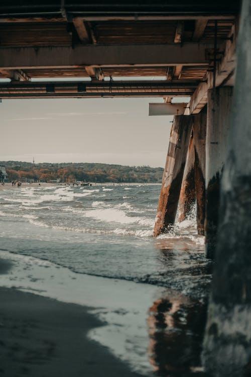 Shabby bridge over rippling sea