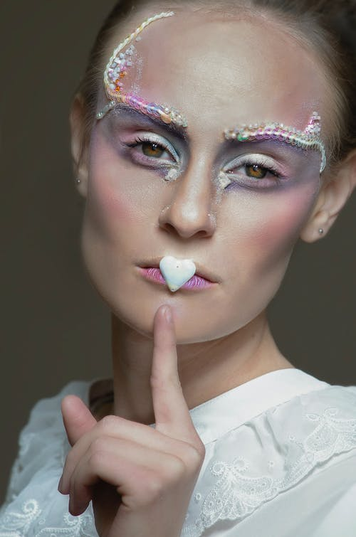 Woman With Pink and White Face Paint