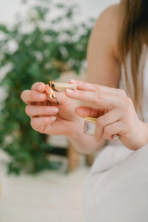 Woman in White Dress Holding Cigarette Stick