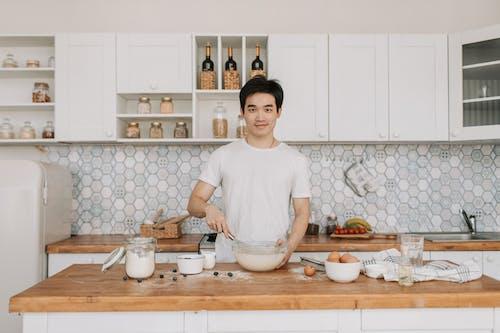A Man in the Kitchen Making Breakfast