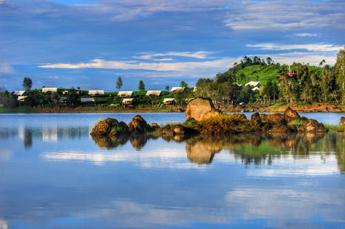 Free stock photo of beautiful, blue sky, blue water, brownstones